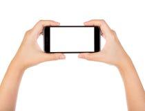 Wręcza mieniu mobilnego mądrze telefon z pustym ekranem Odizolowywającym obrazy royalty free