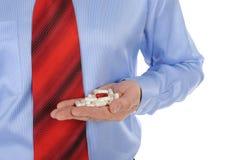 wręcza pastylka męskiego czerwonego biel Zdjęcie Royalty Free