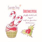 Wręcza patroszoną boże narodzenie babeczkę z holly, cukierek trzciną i doodle buttercream dla ciasto sklepu menu, ilustracja wektor