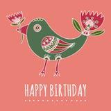 Wręcza patroszonego fantastycznego ptaka jak z ogonem i tulipanem w jej belfrze na różowym tle Obrazy Stock