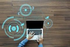 Wręcza pracującego laptop z sci fi futurystycznym interfejsem użytkownika Obraz Royalty Free