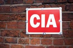 Wręcza writing teksta podpisu inspirację pokazuje CIA pojęcia znaczenia skrót pisać na starego zawiadomienia drogowym znaku z bac Obraz Stock