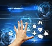 Wręcza wzruszającego futurystycznego interfejs z książeczkami zdrowia - medica Fotografia Stock