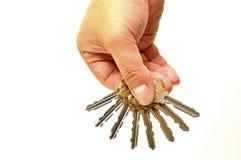 wręcza ludzkich klucze Zdjęcie Stock