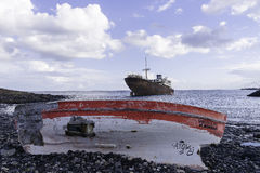 Wrack. The old ship and boat on the beach in Lanzarote island ,Arrecife city in  Spain Stock Photos