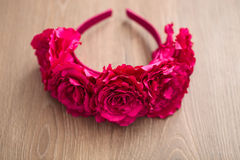Wraith of artificial pink rose flowers on wooden surface. Handmade wraith made of artificial pink rose flowers on a wooden background. Shallow depth of field Royalty Free Stock Image