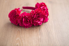 Wraith of artificial pink rose flowers on wooden surface. Handmade wraith made of artificial pink rose flowers on a wooden background. Shallow depth of field Stock Photography
