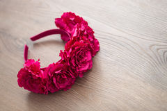 Wraith of artificial red rose flowers on wooden surface. Handmade wraith made of artificial pink rose flowers on a wooden background. Shallow depth of field Royalty Free Stock Images