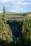 Wrangell St. Elias National Park and Preserve. A bridge on the McCarthy Road leads in the direction of the towns of Kennecott and McCarthy in Alaska's Wrangell stock image