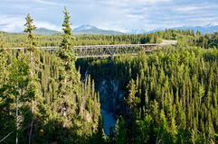 Wrangell St. Elias National Park and Preserve. A bridge on the McCarthy Road leads in the direction of the towns of Kennecott and McCarthy in Alaska's Wrangell stock photography