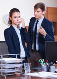 Wrangle between manager and employee. Wrangle between european manager and upset employee at workplace Royalty Free Stock Photography