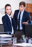 Wrangle between manager and employee Stock Image