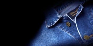 Wrangler della giacca blu isolato su fondo nero Fotografie Stock Libere da Diritti