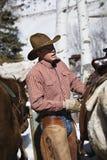 Wrangler with horses. Royalty Free Stock Photos