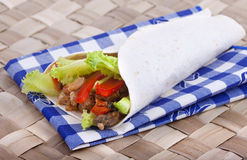 Wrap. Spicy chicken with salad wrapped in a soft flour tortilla Royalty Free Stock Photo