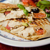 Wrap with chicken, green olives and dry tomatoes Stock Photo
