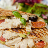 Wrap with chicken, green olives and dry tomatoes Royalty Free Stock Images