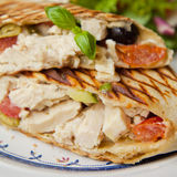 Wrap with chicken, green olives and dry tomatoes Stock Images