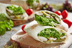 Wrap with chicken and lettuce Stock Images