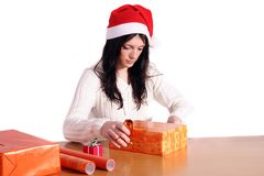 Wrap Christmas presents Royalty Free Stock Images