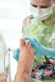 Wrap feet pedicure procedure Stock Photography