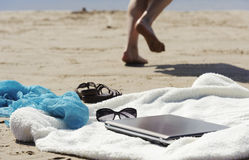 Wrap, laptop, scarf and mules on the beach Stock Photo