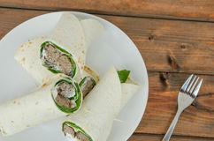 Wrap with pork meal, creame and romaine lettuce Stock Images