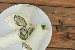 Wrap with pork meal, creame and romaine lettuce Royalty Free Stock Images