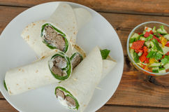 Wrap with pork meal, creame and romaine lettuce Stock Image