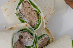 Wrap with pork meal, creame and romaine lettuce Royalty Free Stock Photo