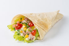 Wrap with salad. On white background royalty free stock image