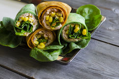 Wrap sandwich. With pink salmon, conr, and spinach in spinach wrap Royalty Free Stock Photo