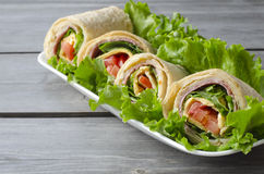 Wrap sandwich. With salami, lettuce, tomatoes and cheeses Stock Image