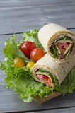 Wrap sandwich. With salami, lettuce, tomatoes and cheeses Stock Images