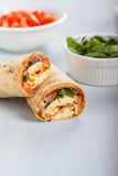 Wrap with tomato, lettuce, harissa and hoummous. Royalty Free Stock Photo