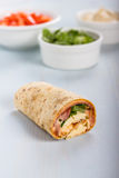 Wrap with tomato, lettuce, harissa and hoummous. Royalty Free Stock Photography