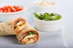 Wrap with tomato, lettuce, harissa and hoummous. Stock Photography