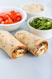 Wrap with tomato, lettuce, harissa and hoummous. Stock Image
