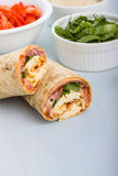 Wrap with tomato, lettuce, harissa and hoummous. Royalty Free Stock Images
