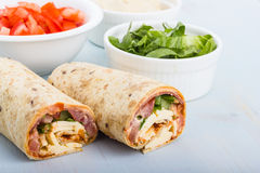 Wrap with tomato, lettuce, harissa and hoummous. Royalty Free Stock Image