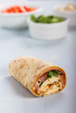 Wrap with tomato, lettuce, harissa and hoummous. Stock Photos