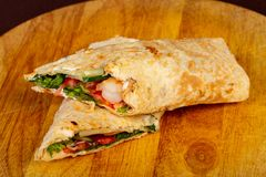 Wrap tortilla with prawn. And vegetables royalty free stock photography