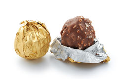 Wrap and unwrap chocolate candy Royalty Free Stock Photo