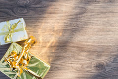 Wraping gifts on a wood plank Stock Photo