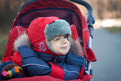 Wrapped baby boy in red stroller Royalty Free Stock Image