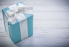 Wrapped blue gift box on wooden board celebrations concept Royalty Free Stock Photos