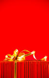 Wrapped box against red background Royalty Free Stock Photo