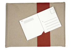 Wrapped box and postcard. Small package together with the attached post card stock image