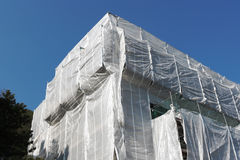 Wrapped building at construction site Stock Image