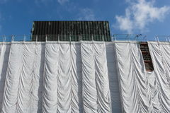 Wrapped building at construction site Royalty Free Stock Photography